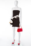 Cocktail dress with red shoes and handbag. Stock Images