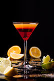 Cocktail drink on black background, citrus fruit on the table. Space in background for copy, text, your words royalty free stock photography