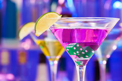 Cocktail drink with dice and lime in the glass Royalty Free Stock Photography