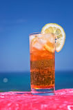 Cocktail drink in front of summer sea Stock Photo