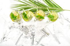Cocktail drink mint ice Cold summer lemonade ice tea. Cocktail drink with lime, lemon, mint and ice. Cold summer lemonade, ice tea, tonic water Royalty Free Stock Images