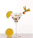 Cocktail. Drink. A  is a mixed drink typically made with a distilled beverage (such as, gin, brandy, vodka, whiskey, tequila, or rum) that is mixed with other Stock Image