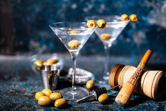 cocktail drink with olives garnish and tools on rusty background Stock Photo