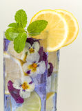 Cocktail drink with violet flowers Royalty Free Stock Photography