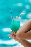 Cocktail drink in woman hand with copy space Royalty Free Stock Photos
