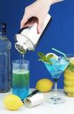 Cocktail drinks. Bartender preparing cocktail drinks - closeup stock photos