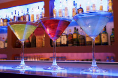 Cocktail drinks. Blue, red and yellow cocktail drinks on a bar Royalty Free Stock Photo