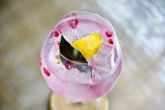 Cocktail drinks, Colorful pink alcohol beverage. Stock Photos