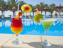 Cocktail drinks by a swimming pool Stock Photo
