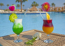 Cocktail drinks by a swimming pool Stock Image