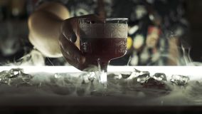 Cocktail with dry ice on the bar.  stock footage
