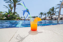 Cocktail at the edge of pool Stock Photo