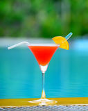Cocktail at the edge of the swimming pool Royalty Free Stock Photography