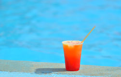 Cocktail at the edge of the swimming pool in summer Royalty Free Stock Images