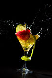 Cocktail with fresh lime and strawberry Royalty Free Stock Images