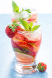 Cocktail with fresh strawberries and citrus in glasses, close-up Stock Photography
