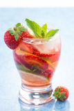 Cocktail with fresh strawberries and citrus in glasses, vertical Royalty Free Stock Photo