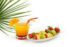 Cocktail and fruit skewers Stock Image