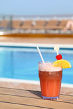 Cocktail with fruits in glass on ship deck floor. Near swimming pool royalty free stock image