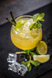 Cocktail garnished with a lime slice and mint leaf Royalty Free Stock Photo