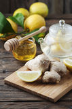 Cocktail with ginger, lemon and honey on the wooden table Stock Image