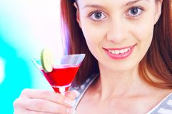 Cocktail girl. High-key portrait of young woman with cocktail  in multicolor back lights. Image may contain slight multicolor chromic aberration as a part of Royalty Free Stock Images