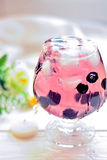 Cocktail in a glass with berries and water splashes Stock Image