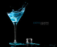 Cocktail Glass with Blue Spirit Drink Splashing. Template Design royalty free stock image