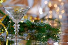 Cocktail glass with Christmas decoration. And reflection Royalty Free Stock Photos