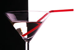 Cocktail glass close-up with red sraw Stock Image