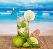 The cocktail glass, is decorated with umbrellas Royalty Free Stock Image