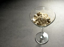 Cocktail glass with diatomaceous earth. Sidelit cocktail glass with diatomaceous earth and spoon Stock Photo