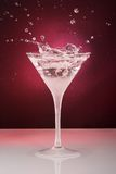 Cocktail glass with drops and ring Stock Photography