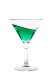 Cocktail glass filled with green inclined drink Royalty Free Stock Photos