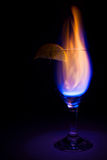 Cocktail glass and fire Stock Photos