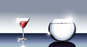 Cocktail glass and fishbowl Royalty Free Stock Photo