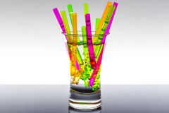 Cocktail glass full of straws, colorful Royalty Free Stock Image