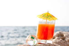 Cocktail and glass globe Royalty Free Stock Photography