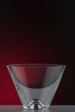 Cocktail glass. On a gradient dark red background Stock Image