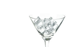 Cocktail glass with ice cubes on white background. Empty Cocktail glass with ice cubes on white background Stock Image