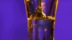 Cocktail in glass isolated on blue, shots stock footage