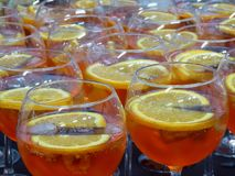 Cocktail glass with lemon and tonic water and campari Stock Images