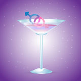 Cocktail glass with male and female signs Stock Photo