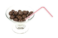 Chocolate balls in glass with straw Stock Image
