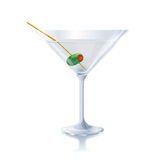 Cocktail glass with olive Stock Images