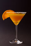 Cocktail Glass. Orange cocktail with orange slice on edge Stock Images