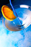 Cocktail glass with orange slice Stock Images