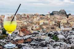 Cocktail glass with panorama view of Corfu old city. stock images