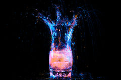 Cocktail in glass with splashes Stock Photography