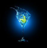 Cocktail in glass with splashes Stock Photos